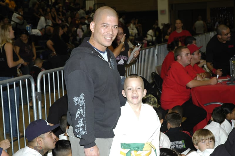 Kai and his dad at a martial arts competition