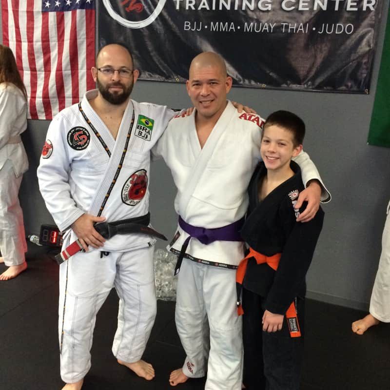 Kai, his dad and instructor in their martial arts uniforms